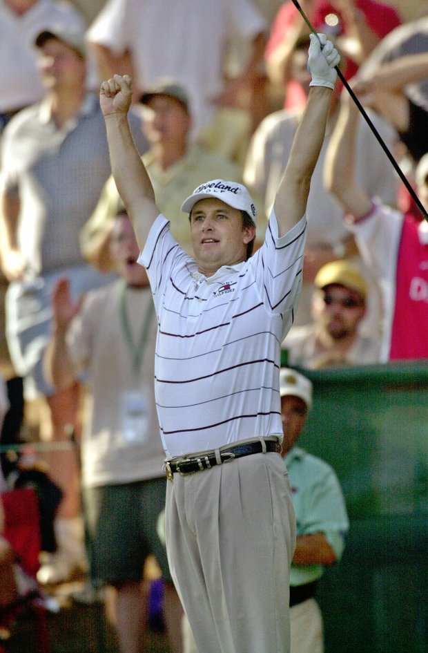 David Toms reacts to his 243-yard, five wood hole-in-one on the par-3, 15th hole Saturday, Aug. 18, 2001, at the PGA Championship in Duluth, Ga.