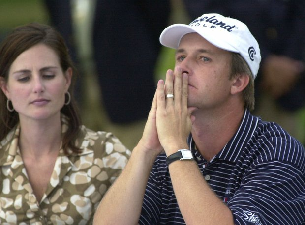 David Toms reacts as he sits with his wife, Sonya during the official trophy presentation after winning the PGA Championship Sunday, Aug. 19, 2001, in Duluth, Ga.