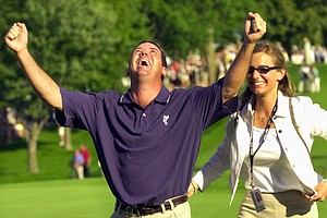 Rich Beem celebrates on the 18th green with wife, Sara, after winning the 84th PGA Championship at Hazeltine National Golf Club in Chaska Minn., on Sunday, Aug. 18, 2002. Beem finished at 10-under-par 278, one stroke better than Tiger Woods.