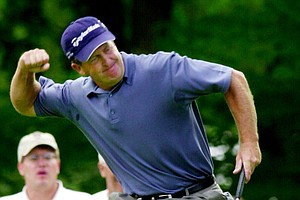 Fred Funk celebrates a birdie on the third hole during the second round of the PGA Championship at Hazeltine National Golf Club in Chaska, Minn., Friday, Aug. 16, 2002.