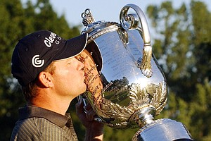 Shaun Micheel kisses the Wanamaker Trophy after winning the 85th PGA Championship at Oak Hill Country Club in Rochester, N.Y., Sunday, Aug. 17, 2003.