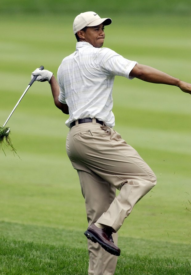 Tiger Woods reacts to a wild shot from the rough along the second hole during the third round of the 85th PGA Championship at Oak Hill Country Club in Rochester, N.Y., Saturday, Aug. 16, 2003.