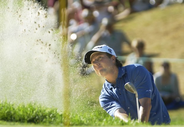 Timothy Clark of South Africa blasts from the trap at the 12th hole during the final round of the 85th PGA Championship at Oak Hill Country Club in Rochester, N.Y. Sunday, Aug.17, 2003.
