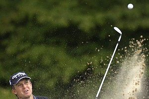 David Toms, of Shreveport, La., blasts from a bunker at the ninth hole where he made par during the first round of the PGA Championship at Whistling Straits in Haven, Wis., on Thursday, Aug. 12, 2004.
