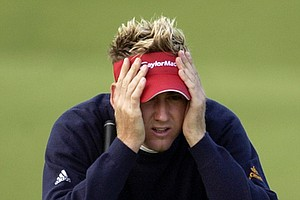 Ian Poulter, of England, lines up a putt on the 10th green during the first round the PGA Championship at Whistling Straits in Haven, Wis., Thursday, Aug. 12, 2004.