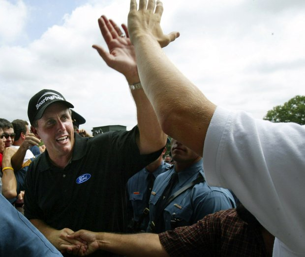 Phil Mickelson gets a high five after winning the 87th PGA Championship at the Baltusrol Golf Club in Springfield, N.J. Monday, Aug. 15, 2005.