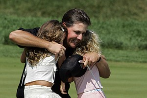 Phil Mickelson hugs his daughters Amanda, left, and Sophia after winning the 87th PGA Championship at the Baltusrol Golf Club in Springfield, N.J. Monday, Aug. 15, 2005.