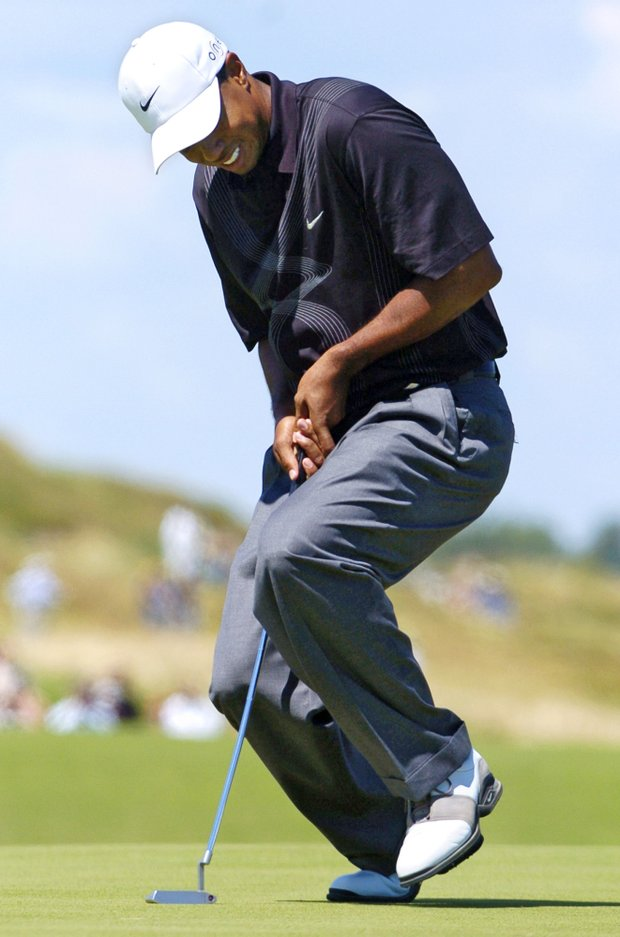 Tiger Woods reacts to a missed birdie putt on the 16th hole during the third round of the PGA Championship at Whistling Straits in Haven, Wis., on Saturday, Aug. 14, 2004. Woods finished at 3 under par for the tournament.