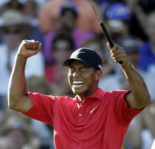 Tiger Woods celebrates after winning 88th PGA Championship golf tournament at Medinah Country Club Sunday, Aug. 20, 2006, in Medinah, Ill.