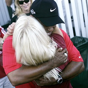 Tiger Woods hugs then wife Elin Nordegren after winning the 88th PGA Championship golf tournament at Medinah Country Club Sunday, Aug. 20, 2006, in Medinah, Ill.