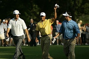 From left, Richard Green of Australia, Tiger Woods and Bubba Watson walk during a practice round for the 89th PGA Golf Championship at the Southern Hills Country Club in Tulsa, Okla.,Tuesday, Aug. 7, 2007.