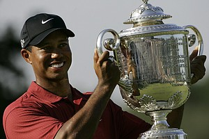 Tiger Woods holds up the Wanamaker Trophy after winning the 89th PGA Golf Championship at the Southern Hills Country Club in Tulsa, Okla., Sunday, Aug. 12, 2007. Woods won his 13th major tournament with an 8-under-par.