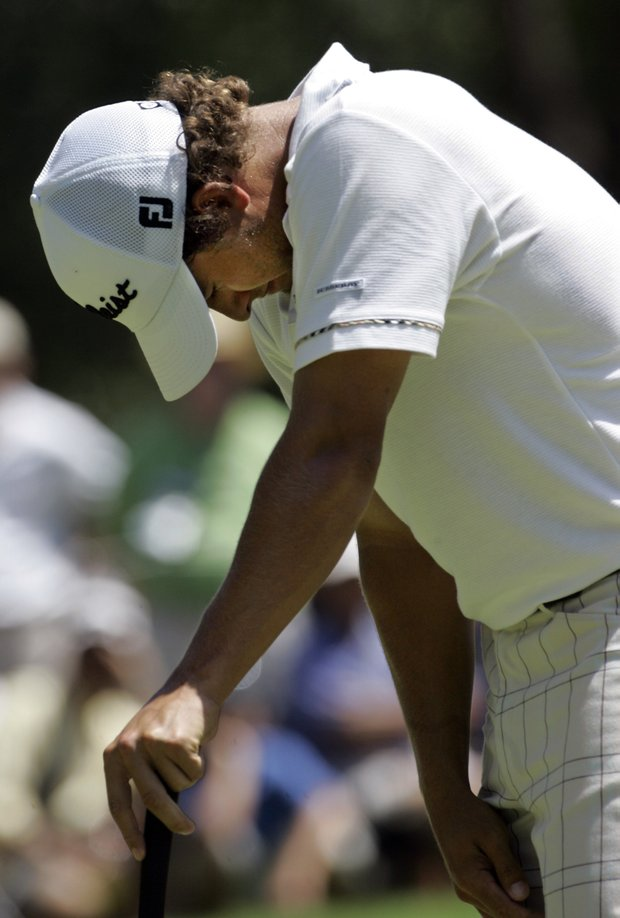 Adam Scott of Australia reacts after missing a birdie putt on the first green during the third round of the 89th PGA Golf Championship at the Southern Hills Country Club in Tulsa, Okla., Saturday, Aug. 11, 2007.