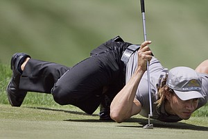 Camilo Villegas, of Colombia, lines up a putt on the second green during the second round of the 90th PGA Championship golf tournament Friday, Aug. 8, 2008, at Oakland Hills Country Club in Bloomfield Township, Mich.