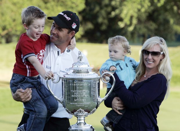 Padraig Harrington, of Ireland, poses with his wife, Caroline, and sons, Patrick, left, and Ciaran, after he won the 90th PGA Championship golf tournament Sunday, Aug. 10, 2008 at Oakland Hills Country Club in Bloomfield Township, Mich.