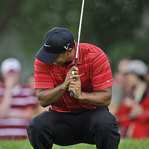 Tiger Woods reacts to his missed birdie putt on the second hole during the final round of the 91st PGA Championship at the Hazeltine National Golf Club in Chaska, Minn., Sunday, Aug. 16, 2009.