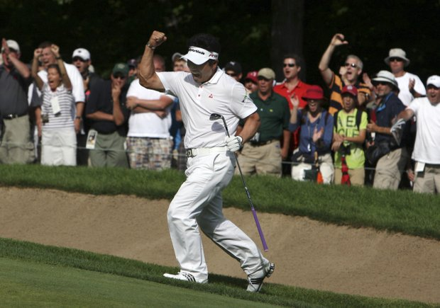 Y.E. Yang, of South Korea, celebrates his eagle on 14 during the final round of the PGA Championship golf tournament Sunday, Aug. 16, 2009, in Chaska, Minn. Yang defeated Tiger Woods by three strokes.