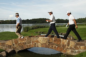 From left, David Toms, Paul Azinger and Phil Mickelson cross a bridge on the 16th fairway during the first round of the 91st PGA Championship at the Hazeltine National Golf Club in Chaska, Minn., Thursday, Aug. 13, 2009.