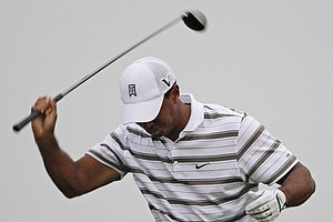 Tiger Woods reacts after hitting his drive on the sixth hole during the second round of the PGA Championship golf tournament Friday, Aug. 13, 2010, at Whistling Straits in Haven, Wis.