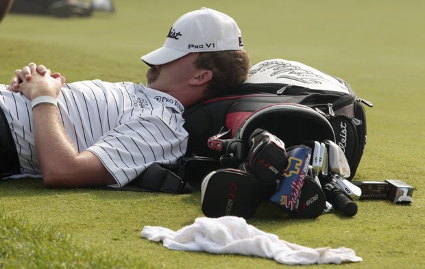 D.A. Trahan rests by the putting green during a fog delay before the first round of the PGA Championship golf tournament Thursday, Aug. 12, 2010, at Whistling Straits in Haven, Wis.