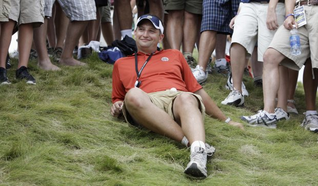 A fan sits with Phil Mickelson's ball on his lap after being hit on the 11th hole during the third round of the PGA Championship golf tournament Saturday, Aug. 14, 2010, at Whistling Straits in Haven, Wis.