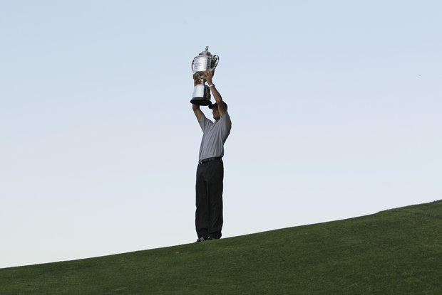 Martin Kaymer of Germany raises the Wanamaker Trophy after winning a playoff in the PGA Championship golf tournament Sunday, Aug. 15, 2010, at Whistling Straits in Haven, Wis.