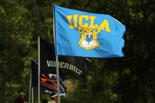UCLA's flag flies near the 18th green during Round 1. They lead after Round 1 by two shots.