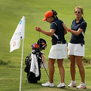 Virginia head coach Kim Lewellen with Calle Nielson after Nielson made a double bogey at No. 9.