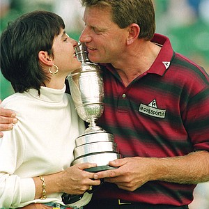 Nick Price celebrates his victory in the 123rd British Open golf championship with his wife, Sue, and the claret jug trophy on the 18th green at Turnberry, England, Saturday, July 17, 1994. Price shot a 12 under par 268.
