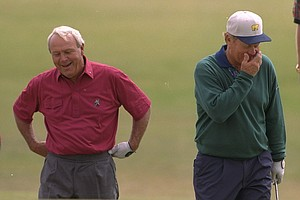 Arnold Palmer, left, looks at the position of his ball in the bunker on the 11th green while Jack Nicklaus laughs on the Old Course at St. Andrews, Scotland, during practice, Tuesday, July 18, 1995. The Open Championships are due to start on Thursday, July 20, 1995. This is expected to be Palmer's last British Open.