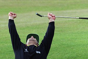 Constantino Rocca of Italy celebrates sinking his birdie putt on the 18th green at St. Andrews Old Course, Sunday July 23 1995, during the final round of the British Open. Rocca forced John Daly into a playoff. Daly won the playoff and won the 124th British Open.