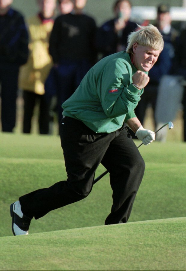 John Daly of the U.S. celebrates his birdie putt on the second hole of a playoff against Constantino Rocca of Italy on the Old Course at St. Andrews during the British Open Championship Sunday, July 23, 1995. Daly won after a four-hole playoff.