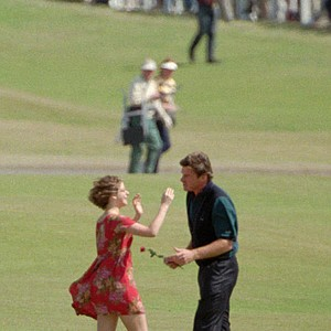 Mimsie Zinopoulous, left, reaches out to kiss British golfer Nick Faldo after giving him a rose on the first fairway of the Old Course during the third round of the British Open Championship Saturday, July 22, 1995.