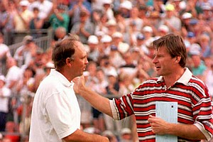 Nick Faldo, right, pats the victorious Tom Lehman on the shoulder after the American won the day to take the 1996 British Open Golf Championship Sunday July 21, 1996, at Royal Lytham & St Annes club. Lehman made a 73 last round for 271 total to take the British Open title.