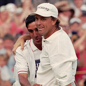 Tom Lehman of the US with his caddy Andy Martinez on the 18th after winning the 125th British Open golf championship at Royal Lytham and St Annes G.C. northwest England, Sunday July 21 1996.