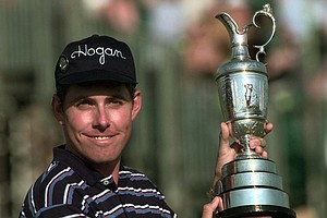 Justin Leonard from the USA with the Open Trophy on the 18th green, Sunday July 20 1997, at Royal Troon Golf Club in Scotland, during the final day of the 1997 British Open Golf Championships.