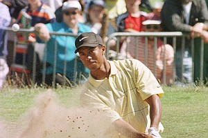 Tiger Woods from the USA fires out of a bunker on the 18th, Saturday, July 19 1997, at the Royal Troon Golf Club in Scotland, during the third day's play in the 1997 British Open Golf Championships.