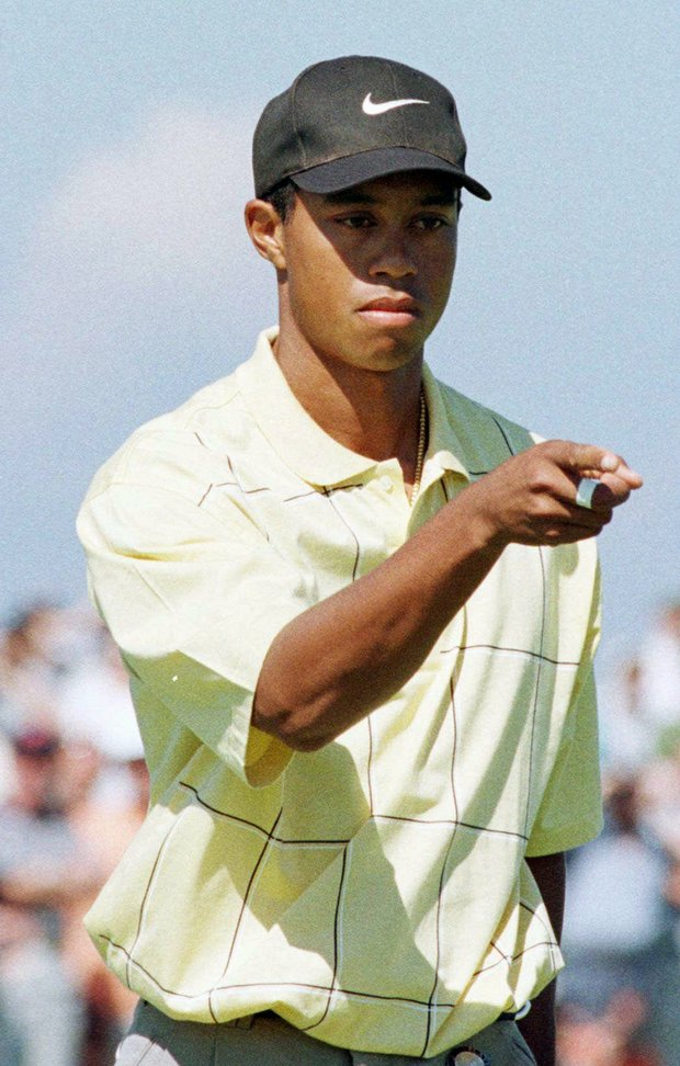 Tiger Woods from the USA gestures after he birdied the second hole, Saturday July 19, 1997, at the Royal Troon Golf Club in Scotland, during the third day's play in the 1997 British Open Golf Championships.