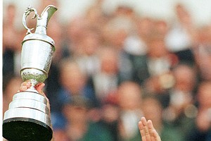 Mark O'Meara from the USA holds up the cup on the18th green, Sunday, July 19, 1998 at Royal Birkdale Golf Club, in Southport, in North West England after winning the 1998 British Open Golf Championships.