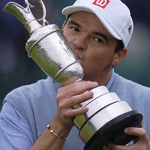Scotland's Paul Lawrie kisses the British Open trophy after his victory in the playoff during the 128th Open Championship at Carnoustie in Scotland, in this July 18, 1999 file photo.