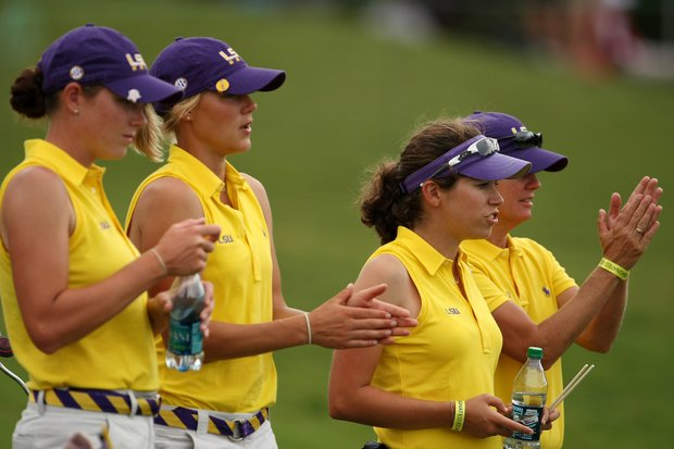 LSU players and assistant coach Alex Rather, second from right, clap during Round 2.
