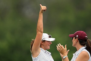 Texas A&M's Katerina Ruzickova gives a thumbs up to the crowd after teeing off at the beginning of Round 2.