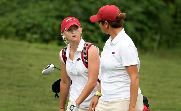 Arkansas' Kelli Shean talks with head coach Shauna Estes-Taylor during Round 2 of the Women's Division I Golf Championships.