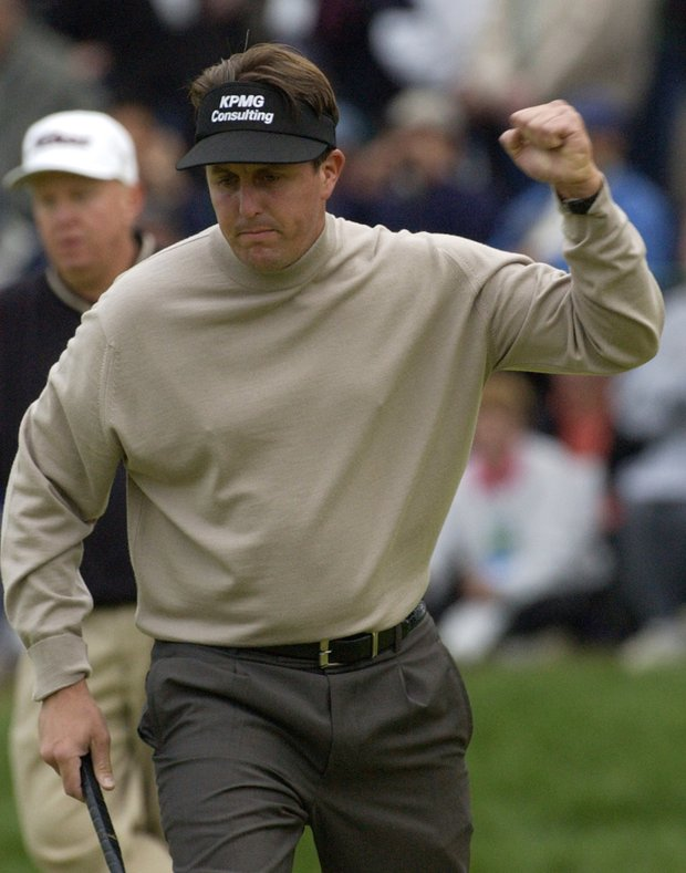 Phil Mickelson pumps his fist after birdeying the 16th hole during the third round of the U.S. Open Golf Championship at the Black Course of Bethpage State Park in Farmingdale, N.Y., Saturday, June 15, 2002.
