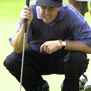 Phil Mickelson lines up a putt on the first green during the final round of the U.S. Open Golf Championship at the Black Course of Bethpage State Park in Farmingdale, N.Y., Sunday, June 16, 2002. Mickelson birdied the hole.