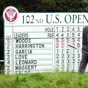 Tiger Woods walks reads the line of his putt on the 18th green during the third round of the U.S. Open Golf Championship at the Black Course of Bethpage State Park in Farmingdale, N.Y., Saturday, June 15, 2002. Woods parred the hole finishing his round at even par and 5-under-par for the tournament.