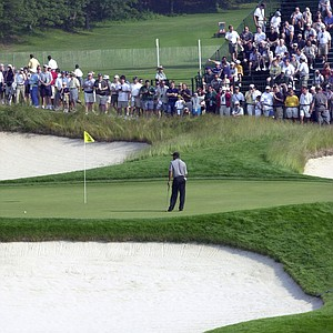 Tiger Woods walks on the 18th green during a practice round Wednesday, June 12, 2002, at the U.S. Open Golf Championship at the Black Course of Bethpage State Park in Farmingdale, N.Y.