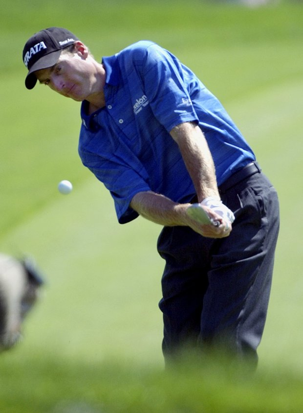 Jim Furyk chips to the first hole during the final round of the 103rd U.S. Open at the Olympia Fields Country Club on Sunday, June 15, 2003, in Olympia Fields, Ill.