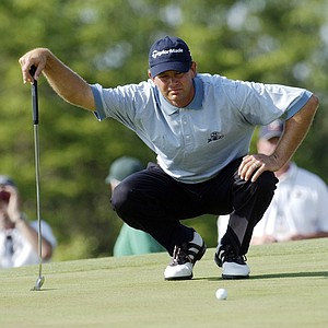 Retief Goosen, of South Africa, lines up his putt on the 11th green during the third round of the U.S. Open, Saturday, June 19, 2004, at Shinnecock Hills Golf Club in Southampton, N.Y. Goosen parred the hole.