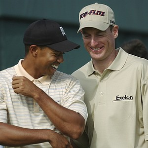 Tiger Woods, left, and defending US Open champion Jim Furyk joke at the 10th tee during a practice round for the US Open at Shinnecock Hills Golf Club Tuesday, June 15, 2004 in Southampton, New York. The US Open starts Thursday, June 17, 2004 at the club.
